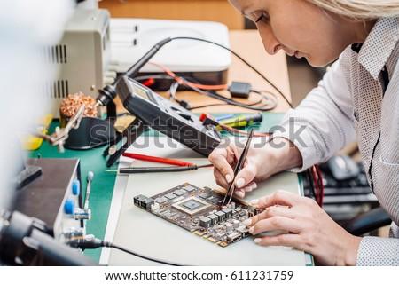 woman repairing computer part...