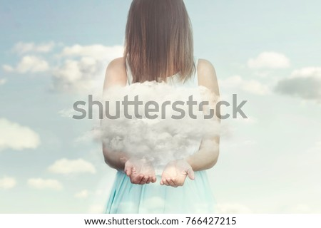 Stock Photo woman resembling an angel guards a small cloud in her hands