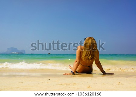 woman resting at the  tropical beach #1036120168