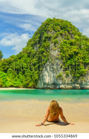 woman resting at the tropical beach of Koh Hong island in Thailand #1055334869