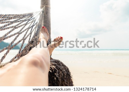 Woman Resting in a Hammock on a Tropical Background. Sea and Rest. Journey. Holiday #1324178714