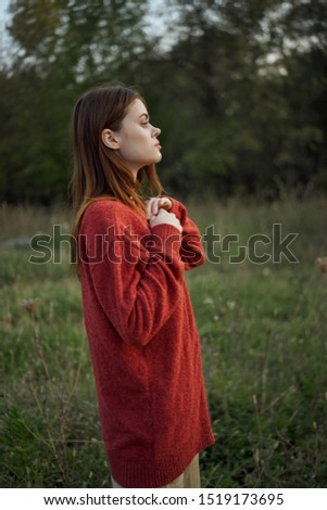 woman resting in red in nature beautiful model #1519173695