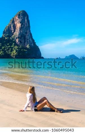 Woman resting on amazing Railay beach in Krabi Thailand. Tropical resort. #1060495043