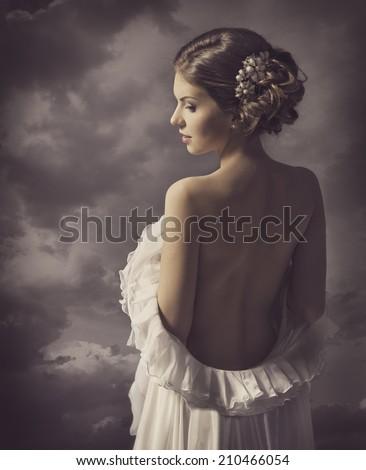Woman retro fashion dress elegant vintage style girl on gray background naked back