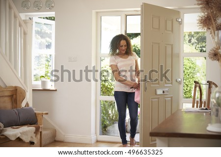 Woman Returning Home And Opening Front Door #496635325