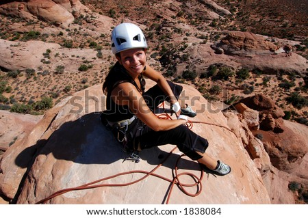 Woman rock climber on the summit - stock photo