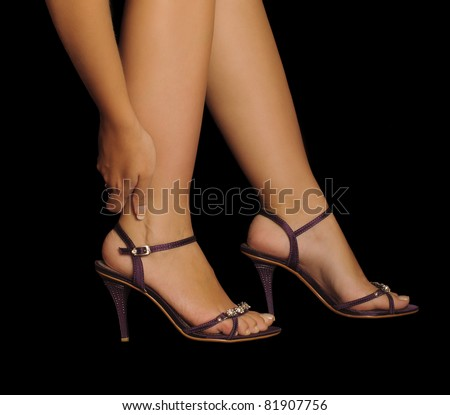 Woman rubbing her leg, pain from wearing high heels, stilettos, beautiful feet and sexy legs