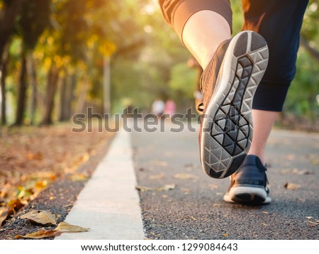 Woman run in park outdoor Trail exercise healthy lifestyle Autumn season