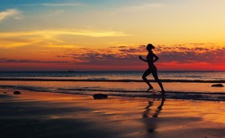 Woman runing  along the sea coast