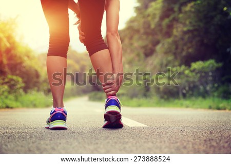 woman runner hold her sports injured leg  #273888524