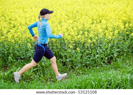 Woman runner running outdoors in spring, jogging and fitness
