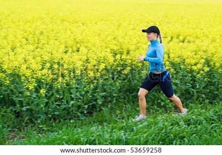 Woman runner running outdoors in spring, motion blur