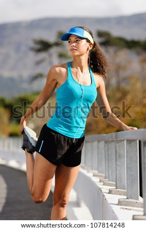 woman runner stretching leg muscle before running outdoors for athlete training.