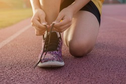 Woman runner tying shoelaces , Run for life