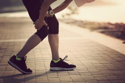 woman runner with sports running knee injury