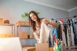 Woman Running Business From Home. Shipping shopping online, young start up small business owner packing cardboard box at workplace. Online selling or e-commerce.