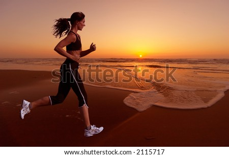 stock photo : woman running during sunset