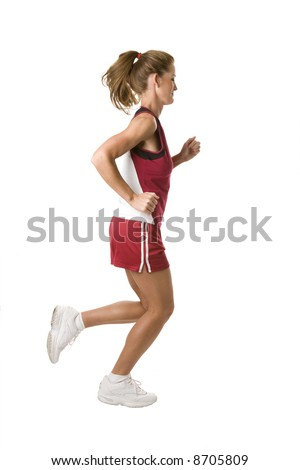woman running for exercise in red top and shorts