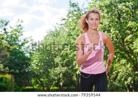 Woman running in the park. - stock photo