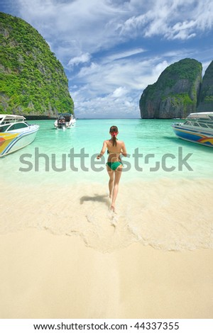 "Woman running in water in beautiful lagoon at  Phi Phi Ley island, the exact place where ""The Beach"" movie was filmed"