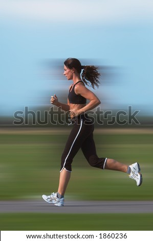 Woman running outdoor(motion blur background)
