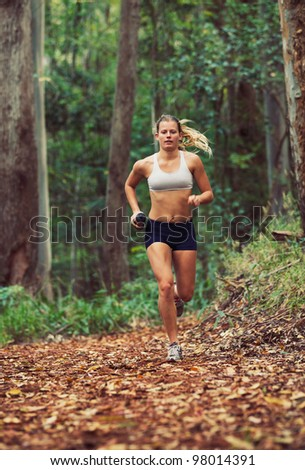 Woman Running Outdoors in Forest