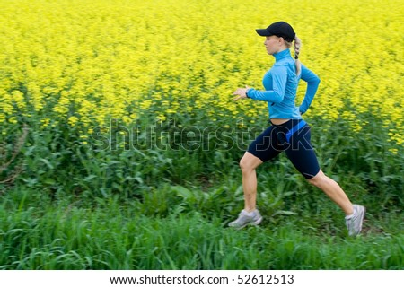 Woman running outdoors, motion blur. Happy young girl jogging or training outside in summer nature, motivational health and fitness concept.