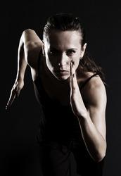 woman running over dark background