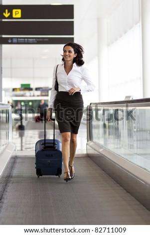 Woman runs at the airport