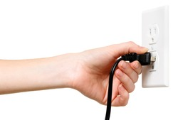 Woman's arm and hand with electrical outlet and plug isolated on white background