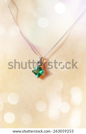 Woman\'s decollete with a luxury jewelry