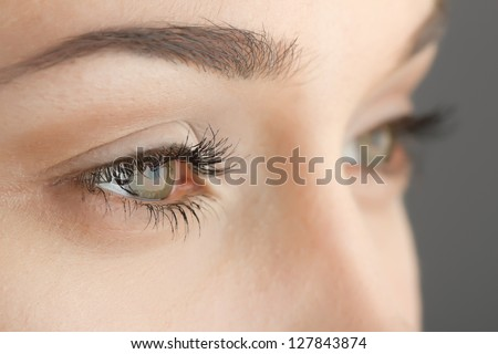 woman's eyes close-up on gray background