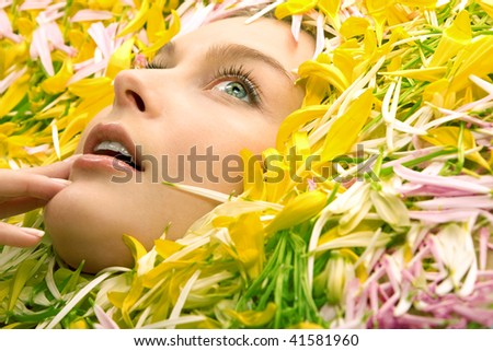 stock-photo-woman-s-face-in-flower-leaves-close-up-41581960.jpg