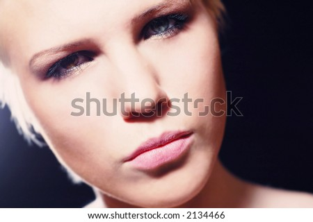 Woman\'s face, she has different eyes, one eye is green and other eye is brown