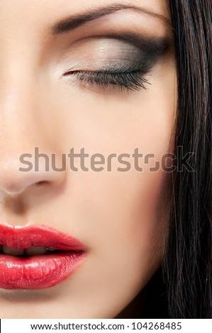 woman's face with make-up with closed eyes