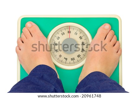 Woman's feet and weight scale isolated on white background