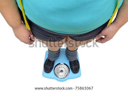 Woman's feet in a scale isolated in white