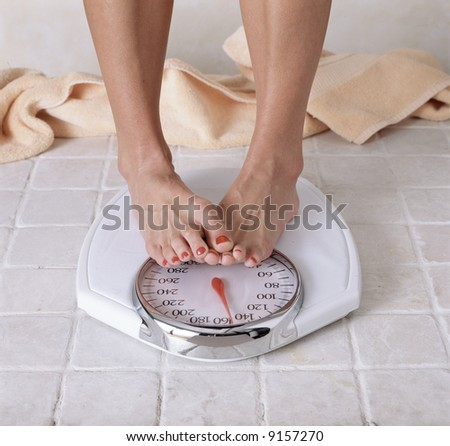 Woman's feet on a scale.