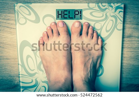 Woman\'s feet on a scale with word HELP! - obesity concept - retro style