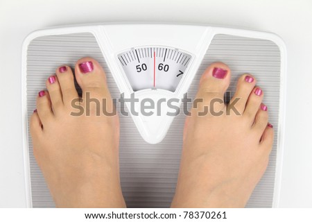 Woman's feet on bathroom scale
