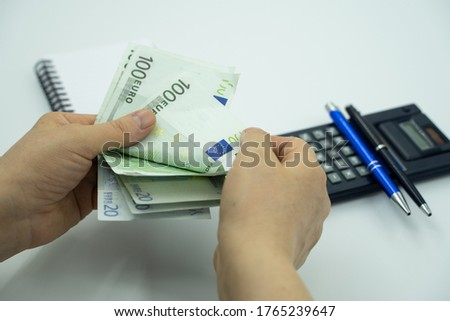 Woman's hand counting avrupa euro and calculating Stok fotoğraf ©