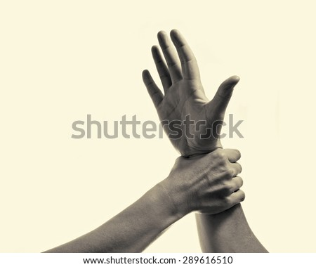 woman's hand gripping his hand stopping male aggression