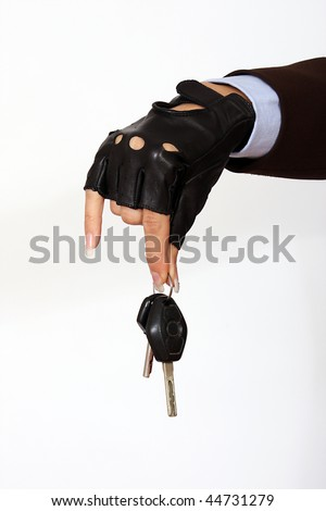 Woman's hand holding a car keys