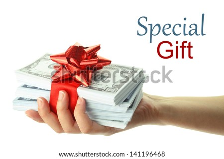Woman's hand holding a gift of money