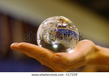woman's hand holding a glass globe