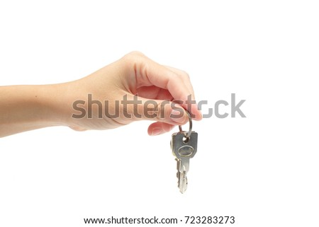 woman's hand holding a key