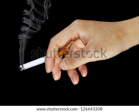 Woman's Hand Holding a Lit Cigarette - stock photo