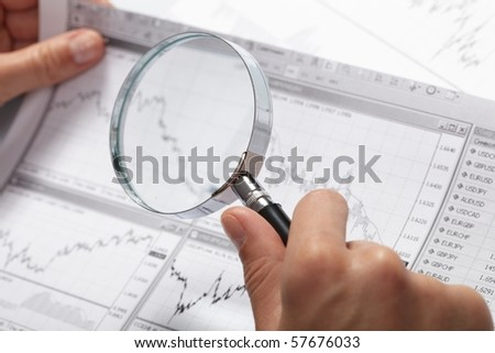 woman?s hand holding a magnifying glass