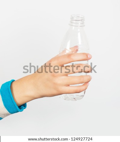 Woman's hand holding a mineral water