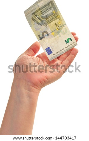 woman's hand holding a note of five Euros